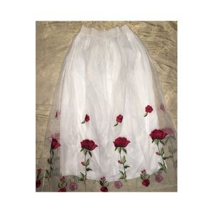 Embroidered floral white skirt.